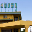 Old Grungy Hotel Sign Above Highway Motel — Stock Photo #9211871