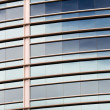 Reflection Pattern of the Sky on a Curved Building - Stock Photo