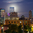 Stock Photo: Glowing Full Moon Rises Behind The Denver Colorado Skyline