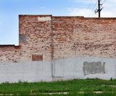Grunge Covered Brick Wall — Stock Photo