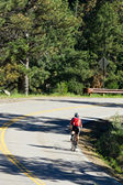 Cyclist Riding Down Road — Stock Photo