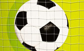 Soccer ball on the wall. — Stock Photo