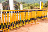 Yellow iron fence. — Stock Photo