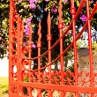 Red iron fence. — Stock Photo