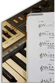 Electronic piano keyboard with Music Score. — Stock Photo