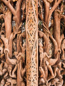 Ancient images carved in wood — Stock Photo