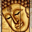 Traditional Thai style Lord Buddhas face wood carving — Stock Photo #10050214