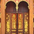 Native Thai style church door wood carving — Stock Photo #10051489