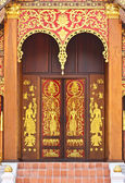 Native Thai style church door wood carving — Stock Photo