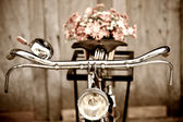 Old bicycle and flower vase — Stok fotoğraf