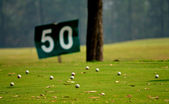 Yard signs in driving range — Stock Photo