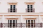 Windows on white building — Stok fotoğraf