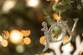 Joy ornament on christmas tree — Stock Photo