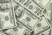 Pile of 100 dollar bills — Stockfoto