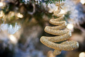 Gold christmas tree ornament — Stock Photo