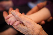 Young and old hands — Stock Photo