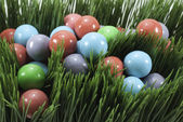 Candy gumballs in grass — Stock Photo