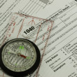 Stock Photo: 1040 tax form, compass, guidance