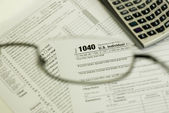 1040 tax form through glasses — Stock Photo