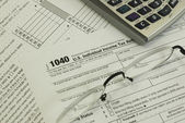 Tax form, glasses and calculator — Stock Photo