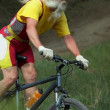 Old man on cicle — Stock Photo #9259155