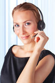 Closeup of a female customer service representative working with — Stock Photo