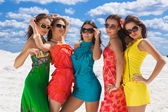 Five sexy girls closeup on the snow ready for party — Stock Photo