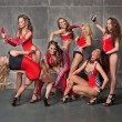 Seven Cute go-go sexy girls in red racing costume - Stock Photo