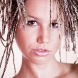 Portrait of beautiful girl with African plaits - Stock Photo