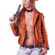 Sexy blond Cowgirl blowing a gun isolated — Stock Photo