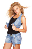 Cute young girl in blue shorts black t-shirt isolated — Stock Photo