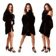 Stock Photo: Beautiful sexy triplets girls in fur coat isolated