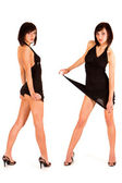 Portrait of two cute sexy twins in black dress — Stock Photo