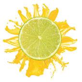 Sliced lime splash with orange juice isolated on white backgroun — Stock Photo
