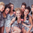Stock Photo: Group of seven happy smiling cute girls in silver go-go costume