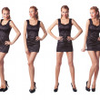 Portrait of four attractive young women in a black dress Full le - Stock Photo