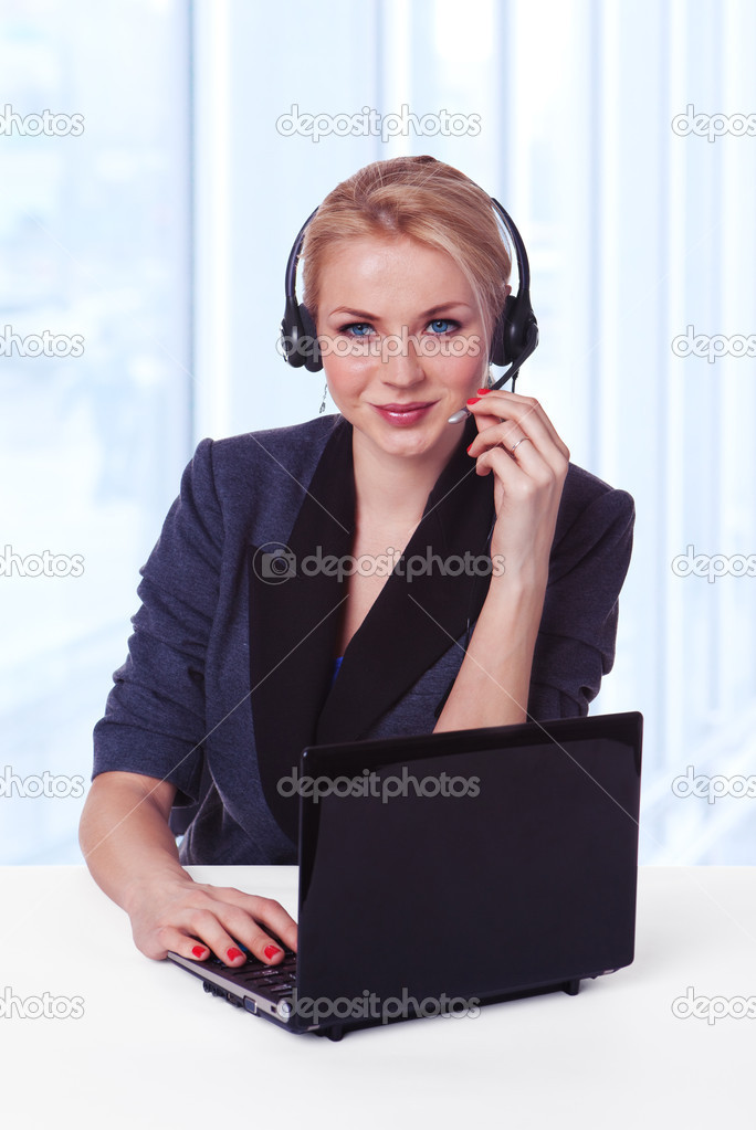 Closeup of a female customer service representative working with headset and laptop. Can I help you? — Stock Photo #9819577