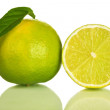 Whole and slice of lime isolated on white background - Stock Photo