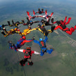 Stock Photo: Group of skydivers flying in formation