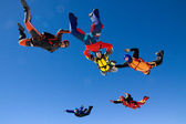Group of skydivers in formation — Stock Photo