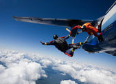Two skydivers jumping from airplane — Stock Photo