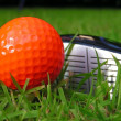 Stock Photo: Orange Golf Ball