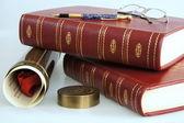 Books and graduation diploma — Stock Photo