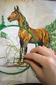 Embroidery a dagger - a horse — Stock Photo