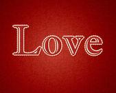 Der text - love - auf rotem grund — Stockvektor