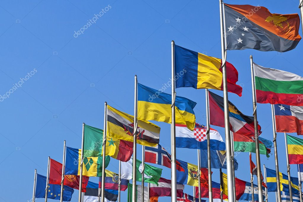 Different countries flags united together against blue sky — Stock Photo #9415594