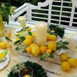 Stock Photo: Table decoration with lemons.