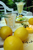Table decoration with lemons. — Stock Photo