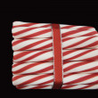 Peppermint Sticks Wrapped in a Red Ribbon - Stock Photo