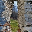 Stock Photo: Hole in stone wall